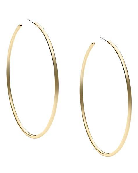 Allen Dons Gold Ribbed Hoop Earrings A La Hilary Duff by Michael Kors Hoop Earrings In Gold Lyst
