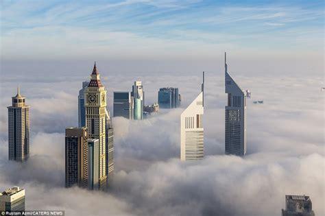 video shows fog descending  dubai daily mail