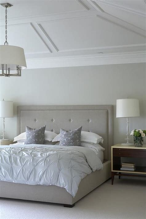 bedroom trim gray tufted bed under vaulted ceiling with decorative trim