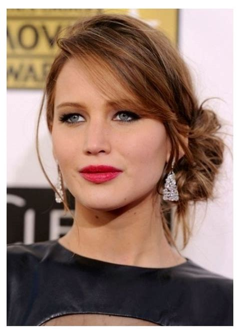 side bangs with bun loose bun with long side swept bangs on a round face