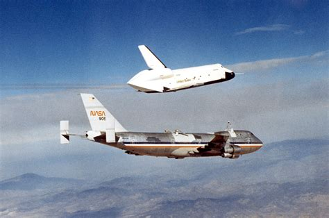 space shuttle nasa lands space shuttle carrying jumbo jet in houston to