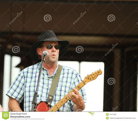 who is the guy who sings and plays guitar in the direct tv commercial man in hat playing guitar during an outdoor concert