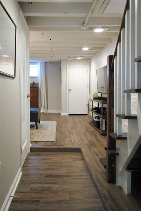 basement floor joists cozy chic basement reno with exposed painted joists wood