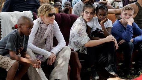 Madonna And Adopted David by Madonna To Lisbon To Help Adopted David Banda