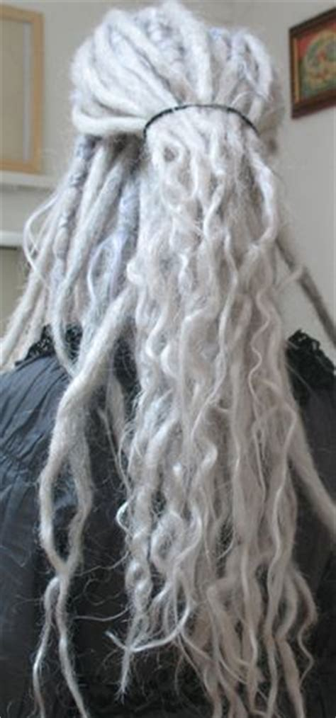 dreadlocks with gray hair actually excited to be an old woman with super long grey