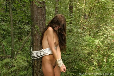 small titty bru te naked and tied up in woods   young