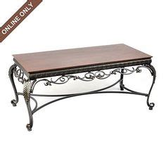 Scrolling Acanthus Leaf Shaped Charger With A Golden Kirklands Coffee Tables