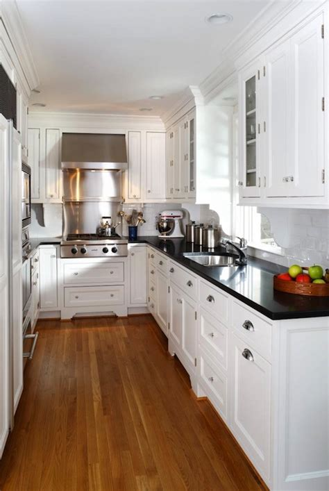 Countertops For White Kitchen Cabinets White Kitchen Cabinets With Black Countertops Traditional Kitchen Ahmann Llc