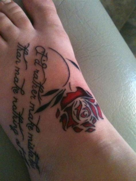 red letter tattoo lettering and flower on foot
