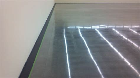 Polished concrete with painted border.