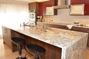 a quot waterfall quot edged granite island is fabricated for a clean modern look scandinavian kitchen