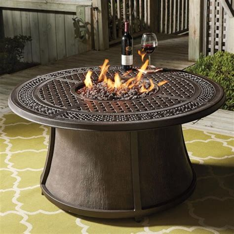 outdoor furniture with pit table signature design by burnella outdoor pit