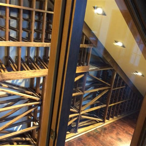under stairs wine cellar a small area under the stairs was brought to life by a