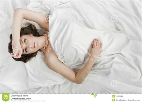 lying in bed beautiful woman lying in bed stock images image 29997244