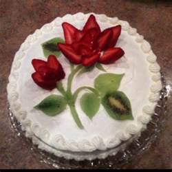 cake decorated w strawberries and kiwi tea
