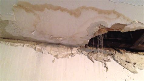 bathtub leaks through ceiling bathroom ceiling leak youtube