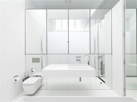 Mirrored Bathroom Wall And Crisp White Bathrooms Pivotech
