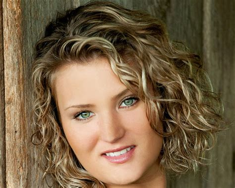 curly face framed hairstyles hair pale highlights frame face this short curly hairstyle