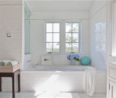 white bathroom subway tile classic shingle beach cottage with neutral interiors home bunch interior design ideas