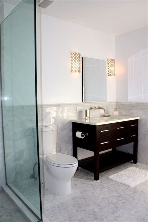 jonathan adler bathroom hexagonal marble floor black cabinet carrera top and