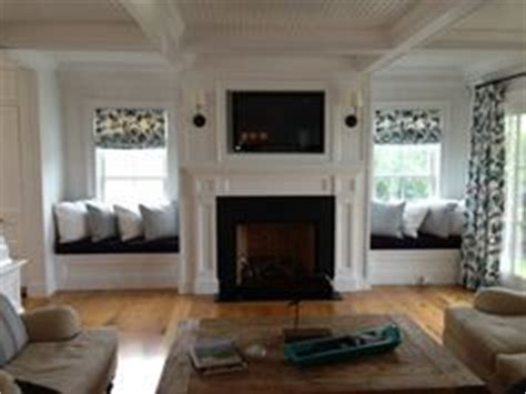 window side seat fireplace mantels with windows on each side and window