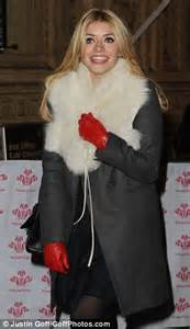 holly willoughby steps   santa style white fur collar