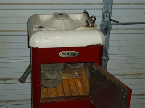 vintage porcelain drinking fountain  icebox
