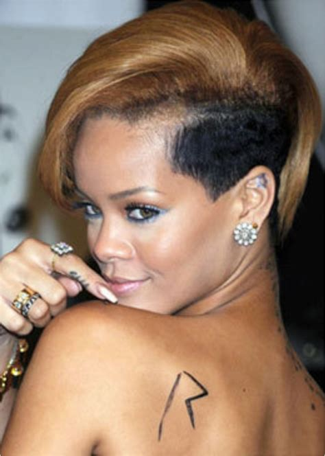 rihanna side tattoo discover the secrets 18 of rihanna s tattoos ritely