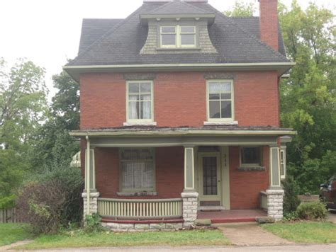 house needs century old red brick house needs new paint for the wood trim
