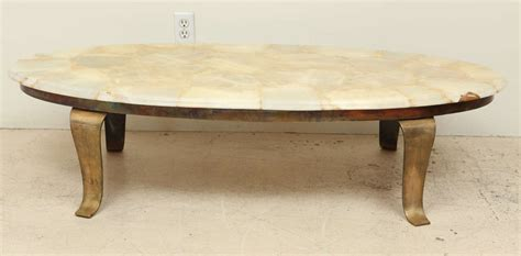 tessallated onyx coffee table with brass base by arturo