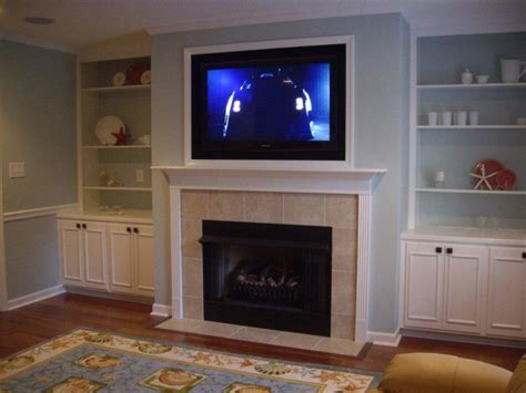 tv over the fireplace for your house living room