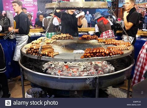 new year food market manchester german barbecue sausage stall at the market in