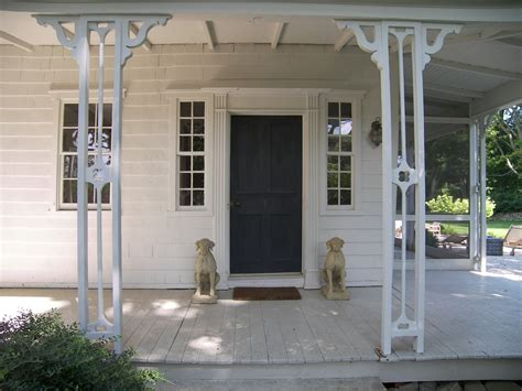 Black Front Door With Framed Sidelights And Dog Statue Front Door Statues