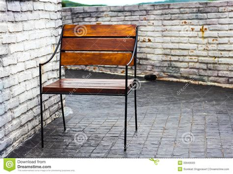 The Chair Is Against The Wall by Chair Against Wall Stock Photos Image 33949593