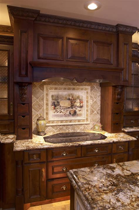 kitchen backsplash mural dark cabinetsg wood cabinets and light sand tones glass tile