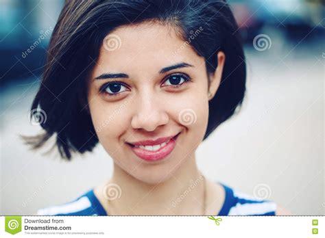 hispanicw with dark hair closeup portrait of beautiful smiling young latin hispanic