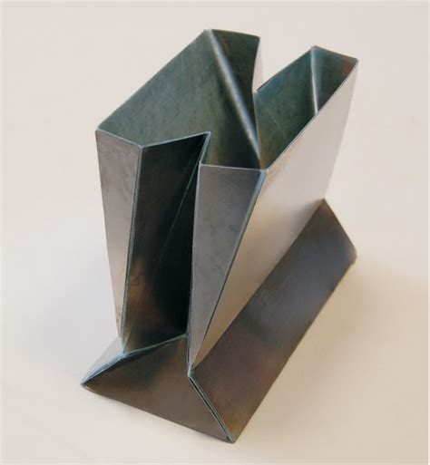 Origami Solutions - origami solution found for folding steel shopping bags