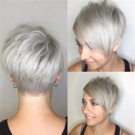 a symmetrical side swept bang pixie women s short textured undercut with long side swept bangs