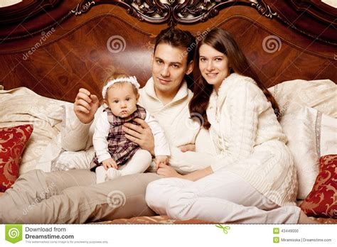 very young kids bedroom with dad video search young happy family playing together on a bed stock photo