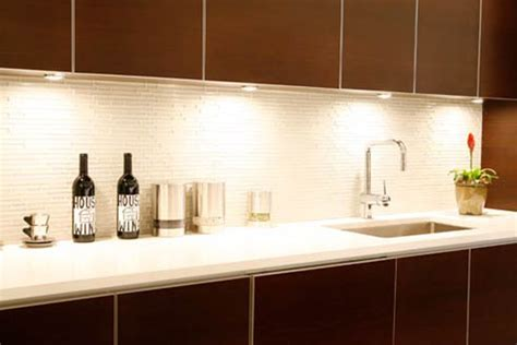 white glass tiles backsplash contrast cabinetry