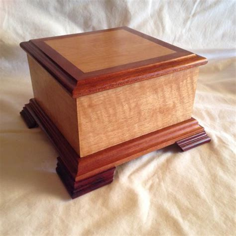 medium exotic wood pet cremation urn  lbs   quilted