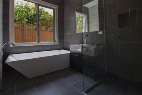 polished bathroom tiles fine honed bluestone tiles 12 charcoal grey bluestone