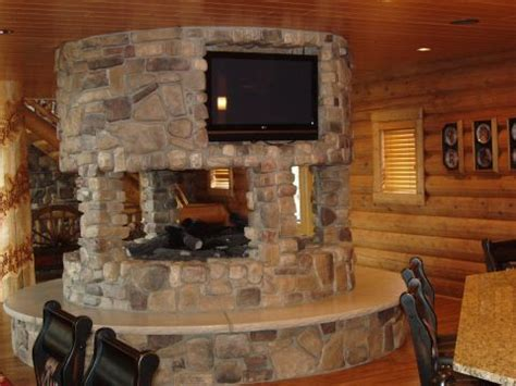 fireplace seating ideas this 360 degree fireplace adds drama and seating in a golden eagle log home for the home