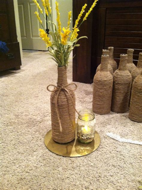 wine bottle candle centerpieces centerpieces i made for my outdoor wedding spray paint cake board with gold foil wrap