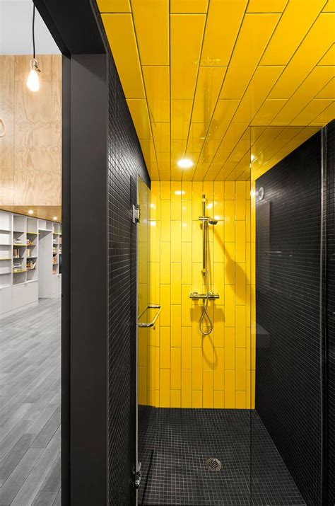 gym bathroom designs a shower with yellow and grey tiles a perfect combination