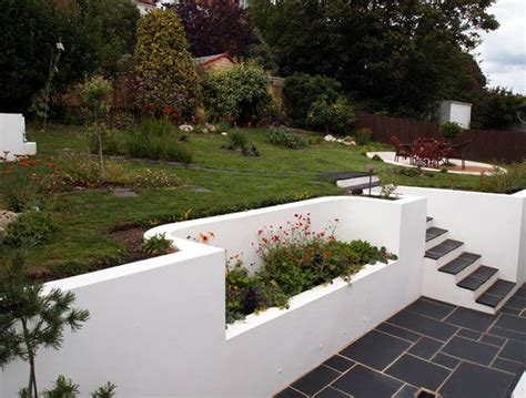 white garden walls rendered wall and slate tiles garden