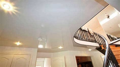 white gloss stretch ceiling enlarges basement space