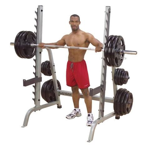 bench press and squat body solid multi press squat half rack w plate storage