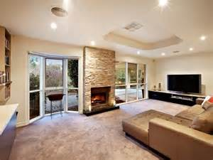 living area ideas open plan living room using brown colours with stone built in shelving living area photo 100858