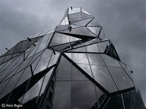 Origami Building - origami like glass building has a striking folded facade